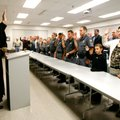 Circuit Judge Doug Schrantz swears in deputies at the Benton County Sheriff's Office on Tuesday in B...