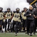 Vanderbilt head coach James Franklin, second from right, leads his team onto the field for the Music...