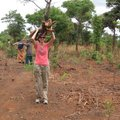 Sara Steinlage carries firewood as part of her chores at the Go Women Go Community group in Mpomgwe,...