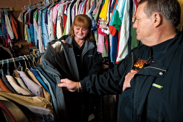 debbie-rutter-left-and-david-forrester-who-were-named-inspiring-people-of-cleburne-county-look-over-some-clothes-at-ssr-helping-hands-in-heber-springs-the-pair-works-with-a-group-that-provides-clothes-for-needy-people-in-cleburne-county-and-were-recognized-by-the-heber-springs-chamber-of-commerce