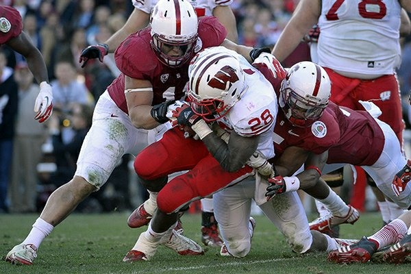 Wisconsin running back Montee Ball (28) tries to break through the Stanford defense during the first half of the Rose Bowl NCAA college football game, Tuesday, Jan. 1, 2013, in Pasadena, Calif. (AP Photo/Mark J. Terrill)