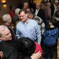 Friends and co-workers congratulate Jeff Harper on becoming the new district judge Tuesday in the Sp...