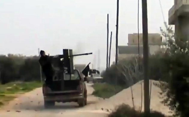 a-free-syrian-army-fighter-fighter-a-weapon-in-taftanaz-village-idlib-province-northern-syria-on-wednesday-jan-2-2013-in-this-image-taken-from-video-obtained-from-the-shaam-news-network-which-has-been-authenticated-based-on-its-contents-and-other-ap-reporting