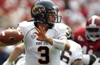 Kent State quarterback Spencer Keith (3) looks to throw against Alabama during the first half of an NCAA college football game on Saturday, Sept. 3, 2011 in Tuscaloosa, Ala. (AP Photo/Butch Dill)