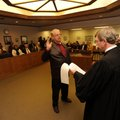 Washington County Tax Collector David Ruff, center, is sworn in Wednesday by Washington County Circu...