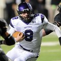 Austin Allen scrambles during Fayetteville's Class 7A state championship game win over Bentonville a...