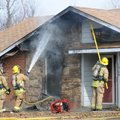 Springdale firefighters hose down the roof while responding to a fire inside the home.