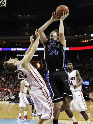 Duke's Ryan Kelly (34) shoots over Davidson's Nik Cochran (12) during the second half of an NCAA college basketball game in Charlotte, N.C., Wednesday, Jan. 2, 2013. Duke won 67-50. (AP Photo/Chuck Burton)