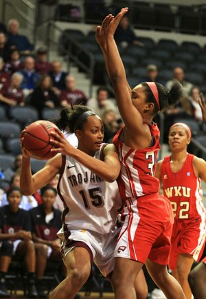 UALR forward Carolee Dillard (left) tries to make a pass as Western Kentucky's Jalynn McClain defends during Thursday's game at the Jack Stephens Center in Little Rock.