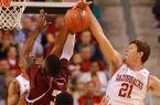 Arkansas sophomore Hunter Mickelson (21) blocks a shot during Arkansas' win over Alabama A&M at Verizon Arena in North Little Rock on Dec. 22, 2012.