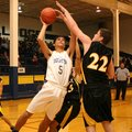 Decatur sophomore forward Mario Urquidi takes a shot under the basket over Hackett's Buddy Nichols ...
