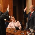 Fayetteville Mayor Lioneld Jordan, right, is sworn in Thursday by Judge Rudy Moore before the start ...