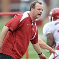 Tim Horton works with Arkansas' running backs during an April 2012 practice at Donald W. Reynolds Ra...