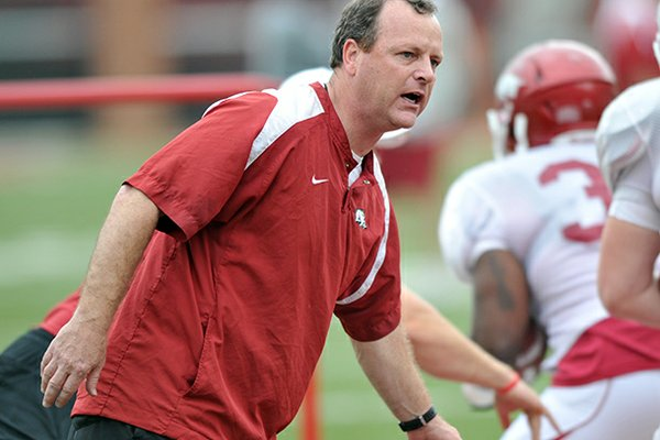 Tim Horton works with Arkansas' running backs during an April 2012 practice at Donald W. Reynolds Razorback Stadium.