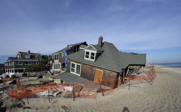 a-beach-front-home-that-was-severely-damaged-two-months-ago-by-superstorm-sandy-rests-in-the-sand-in-bay-head-nj-on-thursday-jan-3-2013