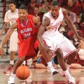 Arkansas guard Mardracus Wade knocks the ball away from Delaware State guard Chris Lewis (34) Saturd...