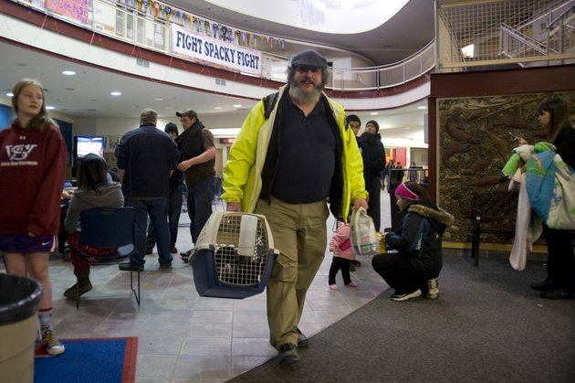 charles-bingham-heads-back-home-with-his-cats-after-a-tsunami-warning-was-canceled-early-saturday-jan-5-2013-in-sitka-alaska-following-a-magnitude-75-earthquake