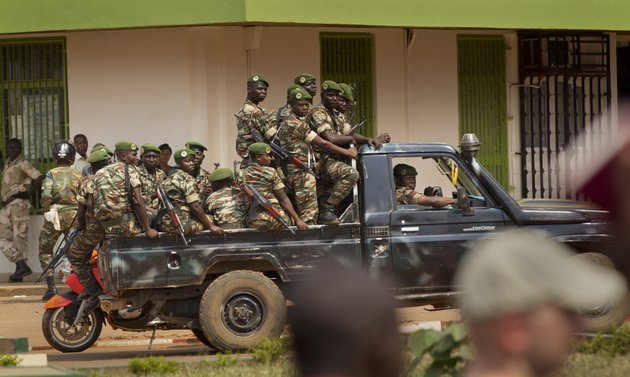 government-security-forces-in-a-pickup-truck-drive-past-a-demonstration-held-by-several-hundred-merchants-calling-for-peace-as-negotiators-prepare-for-talks-with-rebels-from-the-north-in-downtown-bangui-central-african-republic-saturday-jan-5-2013-the-un-security-council-urged-rebels-in-the-central-african-republic-on-friday-to-halt-their-military-offensive-withdraw-from-cities-they-have-seized-and-take-part-in-negotiations-to-find-a-political-solution-to-the-impoverished-countrys-longstanding-problems