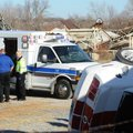 Central Emergency Medical Service employees work Friday to treat a motorist injured after the Ford M...