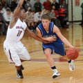 Keifer Holt, right, of Rogers High drives around Treshawn Gause of Springdale High during the second...