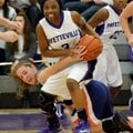 Jaylah Prude, Fayetteville guard, fights for control of the ball Friday against Rogers Heritage guar...