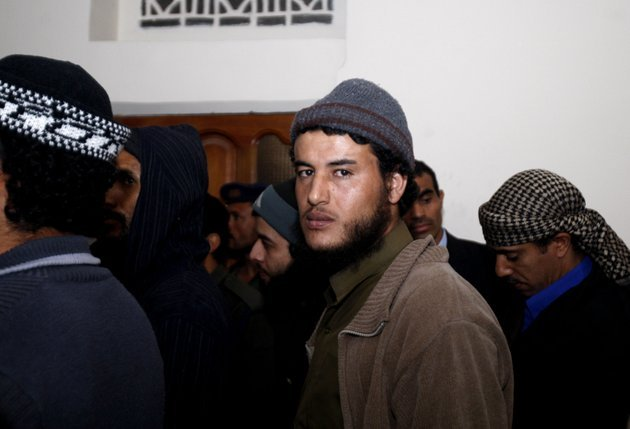 a-suspected-al-qaida-militant-attends-a-trial-session-along-with-other-militants-during-their-trial-at-a-state-security-court-in-sanaa-yemen-sunday-jan-6-2013-yemens-state-security-court-has-sentenced-five-alleged-al-qaida-militants-to-up-to-10-years-in-prison-for-carrying-out-attacks-against-security-forces-and-supporting-the-group-logistically-in-the-southern-province-of-abyan-in-2011