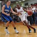 Tereke Eckwood, right, of Springdale High tries to get past Rogers High's Brett Gent on Jan. 4 in ...