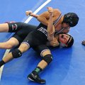 Jay Branch, top, of Fayetteville puts Tristan Engel of Branson, Mo., in a headlock Saturday while re...