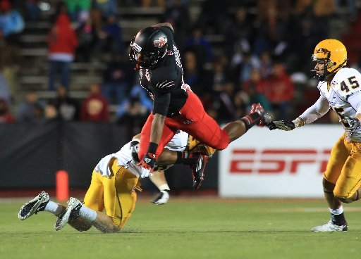 arkansas-state-michael-gordon-goes-high-over-kent-state-dana-brown-during-their-game-at-ladd-pebbles-stadium-in-mobile-ala-sunday