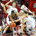 Arkansas center Sarah Watkins (top) and guard Calli Berna put pressure on Texas A&M center Kelsey Bo...