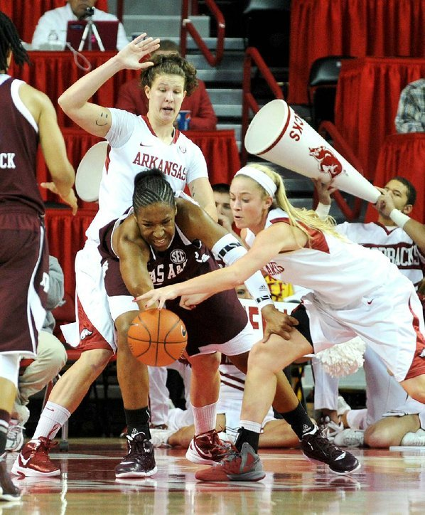 Arkansas center Sarah Watkins (top) ...