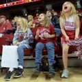 Kora Jagger, 9, from left, Kayla Jagger, 9, and Taci McCoy, 7, all of Rogers, yell as they try to m...