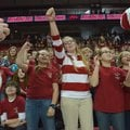 Sami Belford, University of Arkansas band member, in stripes (above), joins Starling Ledbetter, left...