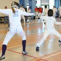 Elizabeth Kirk, left, competes in a fencing match at the Northwest Arkansas Fencing Center in Benton...