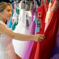 Jordan Maass, 15, looks over a selection of dresses Friday at White Dress Boutique in downtown Roger...