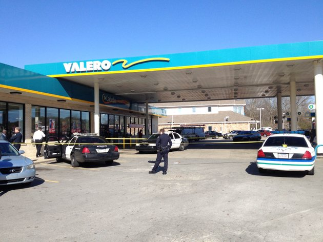 little-rock-police-investigate-the-scene-at-a-valero-gas-station-on-the-corner-of-baseline-and-stagecoach-roads-in-little-rock-where-one-of-their-own-was-hit-by-a-vehicle-while-responding-to-a-shoplifting-call