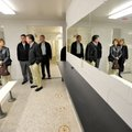 Board members take a look around one of the renovated locker rooms in the Fahring Center at Fayettev...