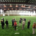 Fayetteville School District board members take a look around the new indoor practice facility at Fa...