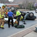 Fayetteville emergency responders attend to the driver of a Toyota Avalon Monday just after 5 p.m. a...