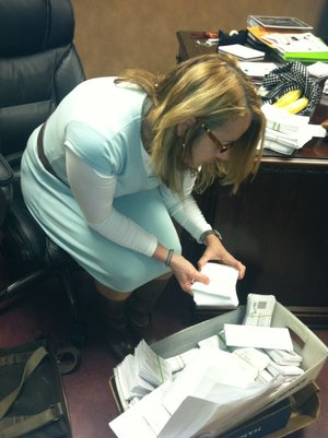 Mary Ley, communications director for the Bentonville School District, looks through survey results Tuesday.