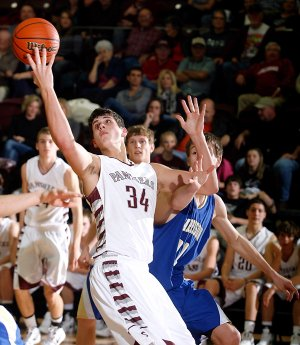 Siloam Springs junior Payton Henson stretches for a rebound against Harrison during the second half in Siloam Springs on Friday, Jan. 20, 2012. On Friday, Henson scored 39 points and grabbed 12 rebounds in the Panther's 69-62 victory against Springdale Har-Ber to earn 7A/6A-West Conference Player of the Week honors.