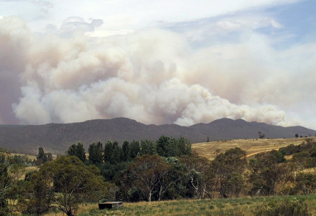 wildfire-smoke-rises-from-hills-near-the-village-of-numeralla-in-new-south-wales-state-on-tuesday-jan-8-2013-wildfires-raged-across-much-of-southeast-australia