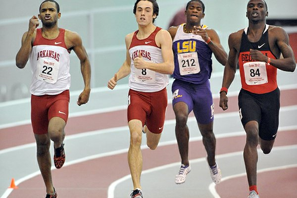 University of Arkansas runners Akheem Gauntlett (left) and Neil Braddy return from the 4x400 relay team that won the NCAA championship in 2012.