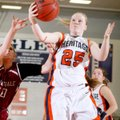 Lacey Murray, a Rogers Heritage senior, pulls a rebound away from Springdale junior Ashley Dederich,...