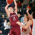 Brittany Jurgens, left, a Springdale senior, attempts a shot under the basket against Rogers Heritag...