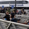 New York City firefighters remove an injured passenger of the Seastreak Wall Street ferry, in New Yo...
