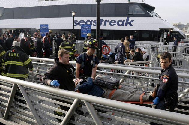 new-york-city-firefighters-remove-an-injured-passenger-of-the-seastreak-wall-street-ferry-in-new-york-wednesday-jan-9-2013-the-seastreak-wall-street-ferry-from-atlantic-highlands-nj-banged-into-the-mooring-as-it-arrived-at-south-street-in-lower-manhattan-during-morning-rush-hour-injuring-as-many-as-50-people-at-least-one-critically-officials-said