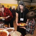Irene Boomhower, left, dishes up her plate as Tena Reese, center, helps her son, Caleb Reese, 11, wi...
