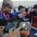 Jack Meyer, Adam Eisa and Mason Sell, from left, Kirksey MIddle School sixth-graders, use smart phon...