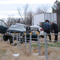 A state trooper investigates the scene of a one-car accident Tuesday on Interstate 540 north of the ...